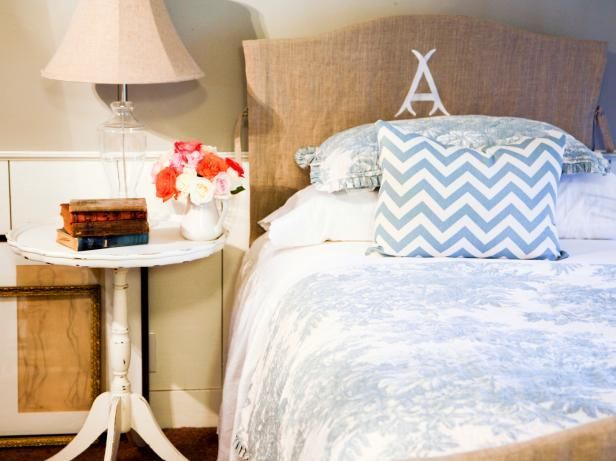 Update a basic wooden headboard with a simple slipcover using no staples or batting just interesting fabric, ties and a monogram.