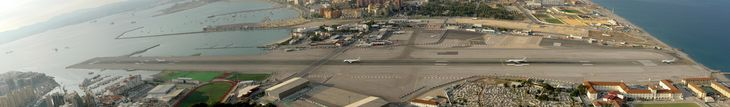 Gibraltar Airport. Midway through there is an intersection with cars and red lights.  Looks like fun!