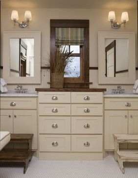 Love the design of this Jack and Jill bathroom.  Especially love how the sinks are divided by another mirror and drawers.