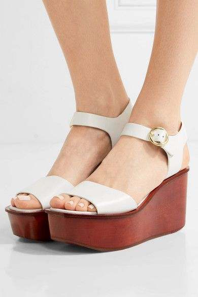 Heel measures approximately 45mm/ 2 inches with a 40mm/ 1.5 inches platform  White leather Buckle-fastening ankle strap Imported