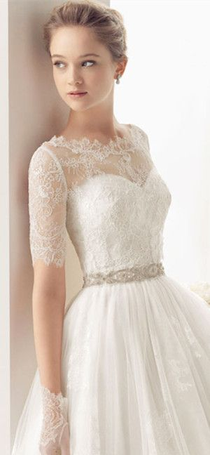 I love this overlay in lace. could turn any strapless gown into a more modest dress.