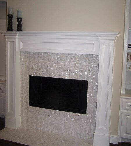 I love the pearlescent mosaic tiles around the fireplace! This would look amazing around my fireplace - and it's at the same weird mid-wall height as mine, too!