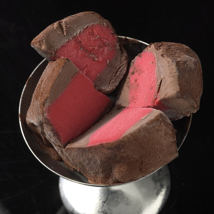 Raspberry Sorbet. Centred in Dark chocolate. Individually wrapped. Ready to serve and enjoy!