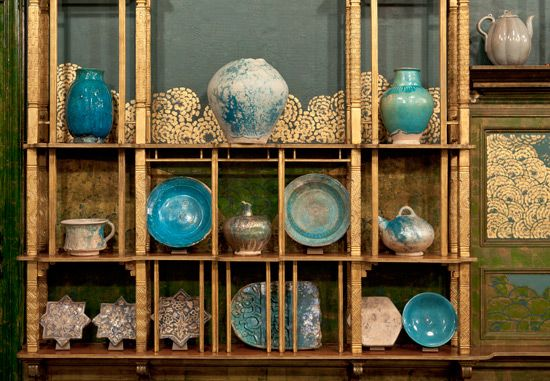 The West Wall displays iridescent Raqqa ware, named for the site in northern Syria where the ceramics originated. Viewed together, the shelves form a ceramic still life in various shades of turquoise. The West Wall displays iridescent Raqqa ware, named for the site in northern Syria where the ceramics originated. Viewed together, the shelves form a ceramic still life in various shades of turquoise. F1904.61