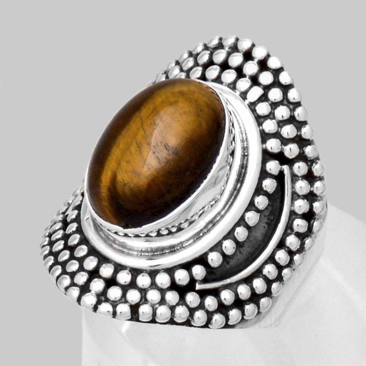 Inel oval antichizat lucrat manual prin tehnica granulaţiei şi ochi de tigru caboşon. Cod produs: EI14 Greutate: 10.89 gr. Circumferință inel: 55.00 mm Piatră: OCHI DE TIGRU