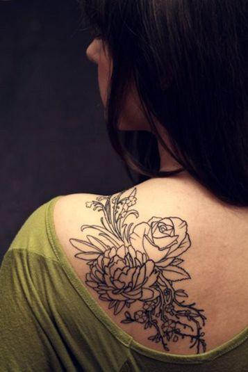 Outline flower tattoo on shoulder blade