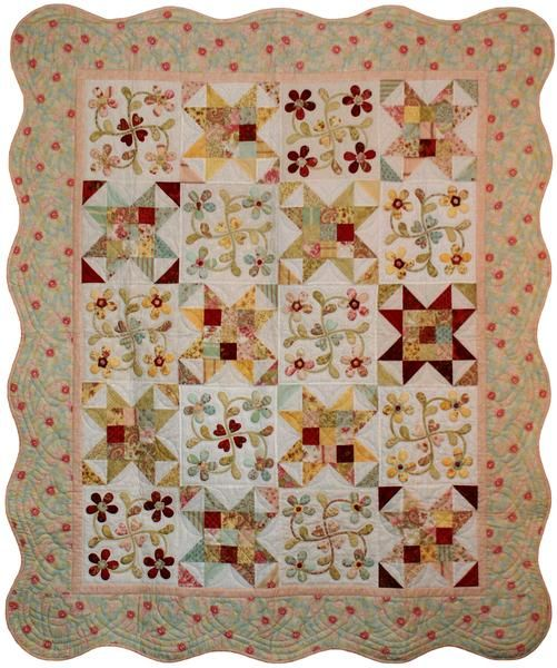 """A lovely mix of piecing and appliqué flower blocks. This quilt is finished with a scalloped border, giving it a wonderful fresh look.  This pattern includes full sized patterns and is a great project to use up scraps of fabric you may have in your stash. Suitable for intermediate quilting skill levels. Quilt measures 66"""" x 78"""""""