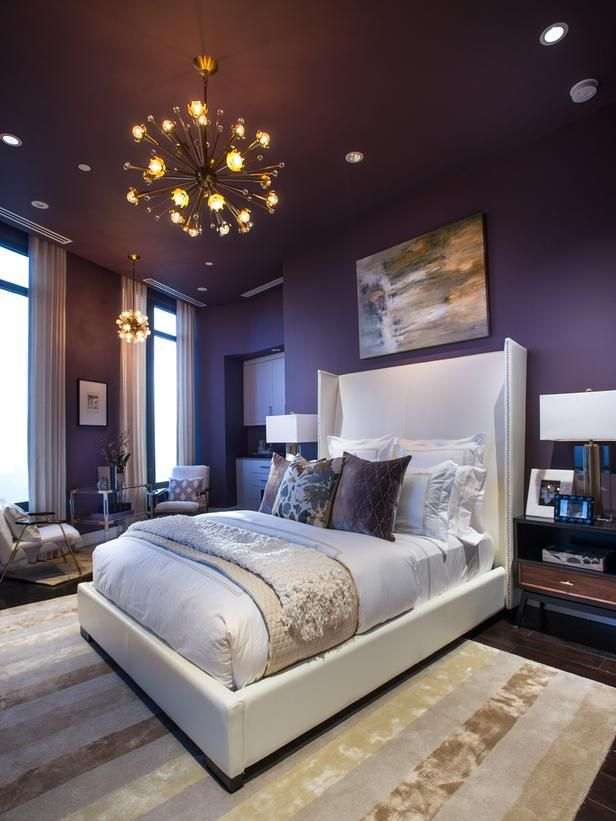 A tufted area rug with neutral stripes tones down the sultry plum found in  the walls