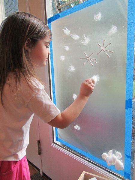 sticky paper snow mural for preschool