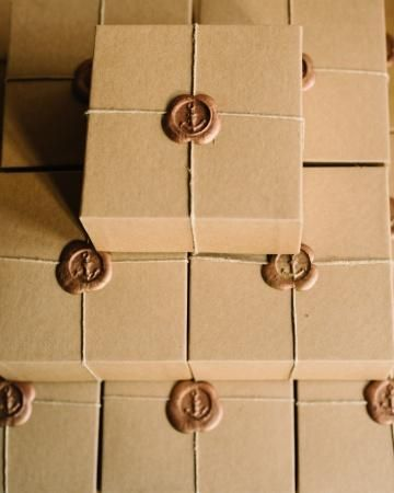 Boxes of saltwater taffy finished with anchors stamped in a gold wax seals