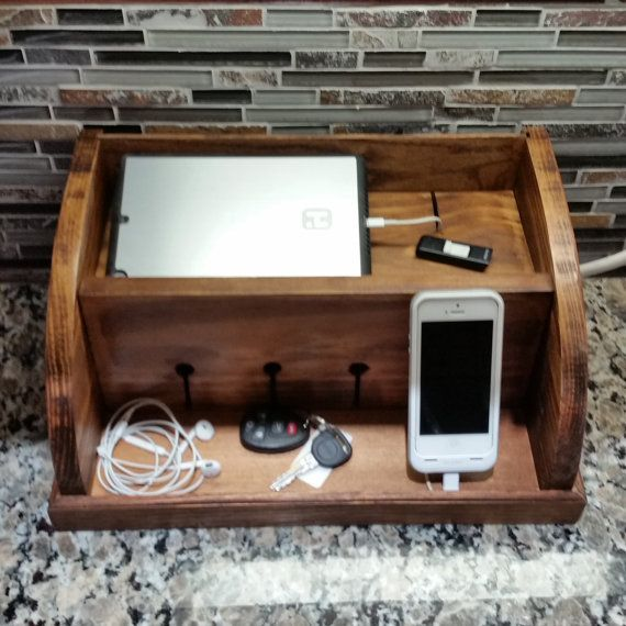 Organize all of your electronic devices with this rustic charging station valet. This is perfect for keeping all of your Smart gadgets organized and charged. You can charge up to 6 devices all plugged into a power strip (not included) that fits nicely in the back. Just slide the back panel up, plug in your devices, and youre ready to go with all the cords hidden. You can choose in the drop down which side you would like the hole for the power cord drilled on.  This organizer measures 15…
