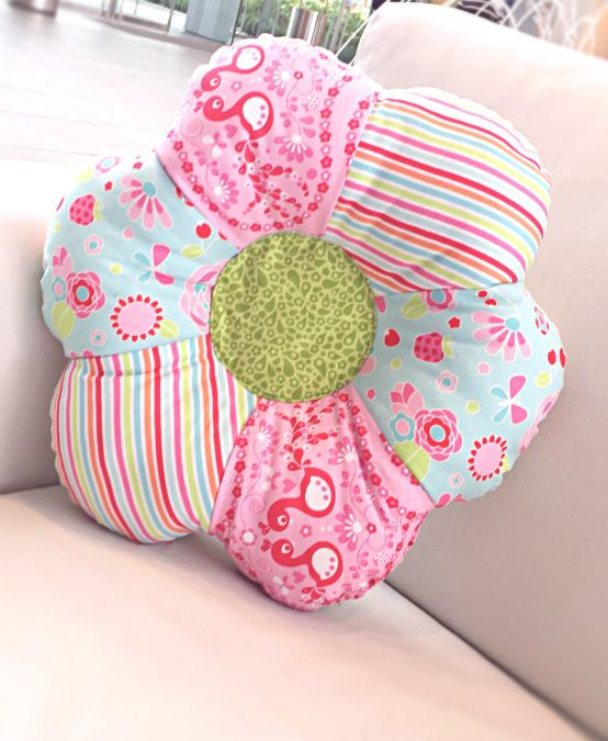 Accent your little girl's room with this easy flower shaped pillow pattern using sewing scraps and 30 minutes.