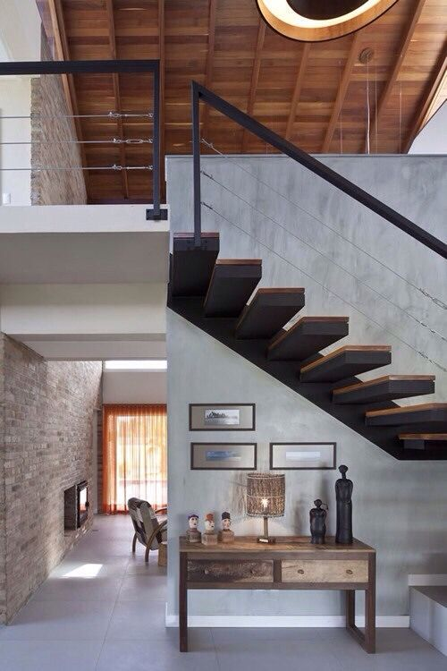 Modern loft space home decor and design. Stairs with cool tones, monotone  brick wall, and traditional decoration.