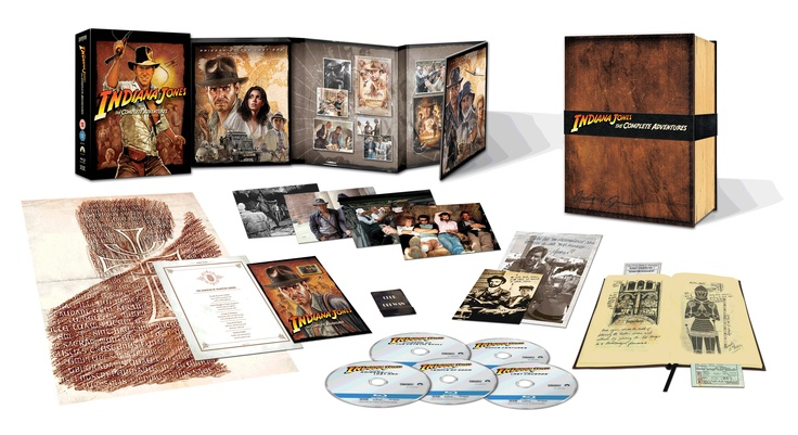 The Blu-ray Box Set in all its glory!    This limited edition set, only available online, will also come with rarely seen behind-the-scenes stills, a film cell with newly produced artwork and a special collectable package resembling Indiana Jones' journal.     Contents: Reproduction Holy Grail prop (144 pages), film cell, grail rubbing, menu from Pankot Palace, four rare film stills, Club Obi-Wan matchbook, travel tickets, and two photos.    P.s. Temple of Doom is UNCUT!
