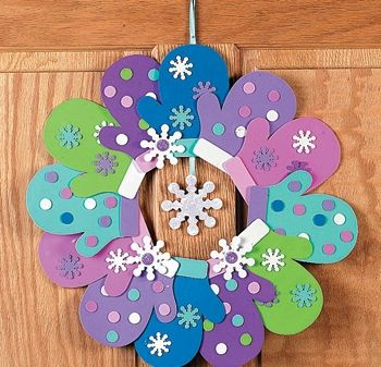 Use construction paper & glue onto white cardstock paper ring or paper plate ring for support. Bring hole puncher into room, have yarn available. For dangly, make a construction paper star instead of a snowflake and they can glue punched-out snowflakes all over star if they want.