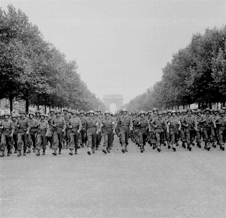 American troops of the 28th Infantry Division march down the Champs Elysees in Paris on August 29 1944. They had liberated Paris a few days before.