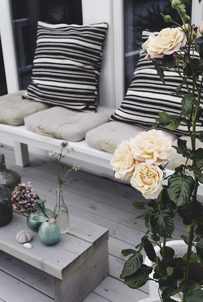 Striped cushions and coloured vases. Easy updates for your patio. More ideas at www.redonline.co.uk