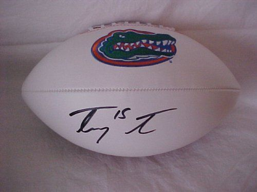 Tim Tebow Hand Signed Autographed Florida Gators Full Size NCAA Football by NCAA. $149.99. THIS IS AN OFFICIAL FULL SIZE NCAA COMMEMORATIVE FLORIDA GATORS LOGO FOOTBALL AUTOGRAPHED BY TIM TEBOW. THIS FOOTBAL WAS HAND SIGNED AND THE SIGNATURE IS NOT A PRINT. EACH AUTOGRAPH COMES WITH A CERTIFICATE OF AUTHENTICITY AND TAMPER-PROOF HOLOGRAM.