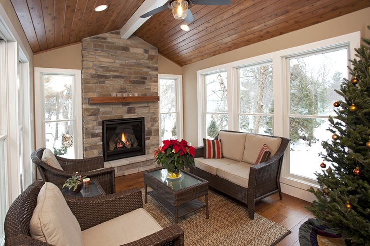 4-Season porch: Cedar ceiling (hand-framed), hand-scraped maple wood flooring (heated), natural stone fireplace, white accent beam and enamel windows and baseboard. Woodbury, MN