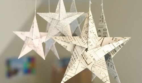 5 pointed origami stars hanging on mirror- I like the newspaper look.  It would be pretty with scrapbook paper too!
