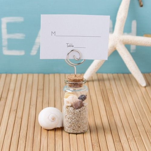 Fill this glass jar place card holder with sand and shells for a beach wedding