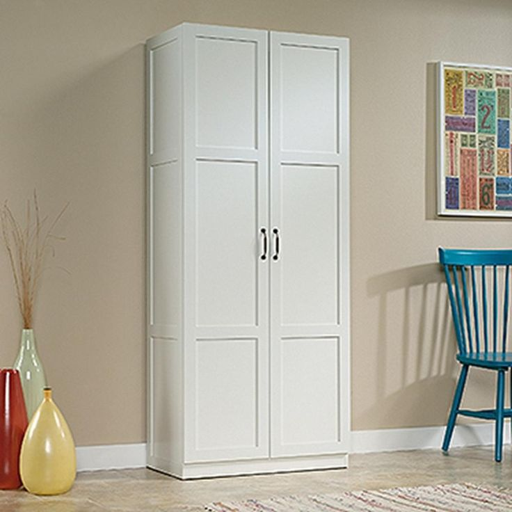 something like this for the laundry Sauder Woodworking White Cabinet-419636 - The Home Depot