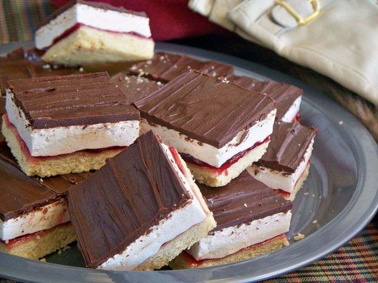 Who could resist fluffy marshmallow and jam sandwiched with a buttery biscuit base. You'll love these Wagon Wheel Slices and don't miss the homemade Marshmallow Fluff and Choc Mallow Jelly Slice!