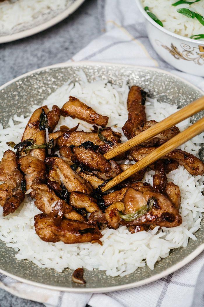Eating Chinese garlic chicken with chopsticks