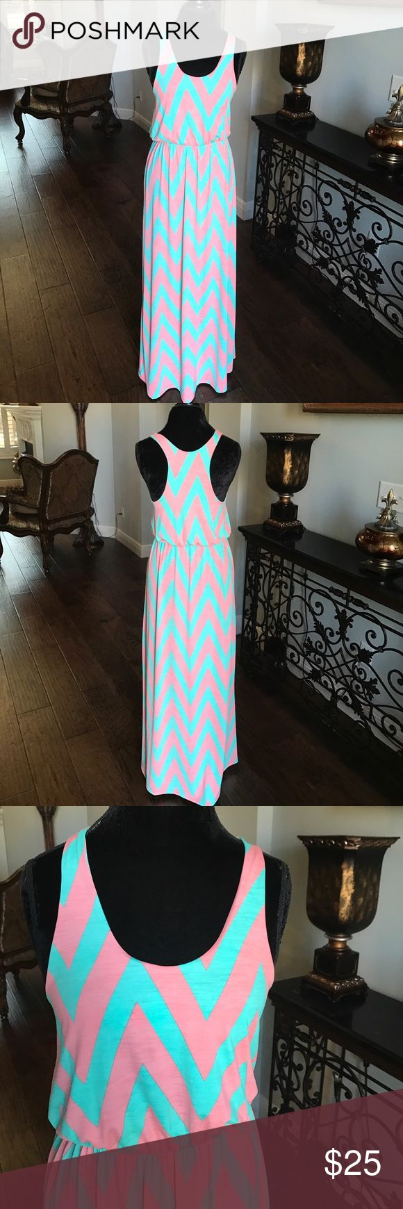 Pink-Blue Striped Maxi Dress Pink and blue chevron maxi is classy, fabulous and perfect for spring. Comfortable racer-back. And everybody knows maxi dresses are the ladies equivalent of sweat pants. Never worn. Excellent condition. Fascination Dresses Maxi