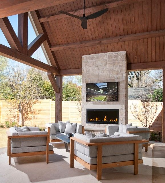 Modern outdoor fireplace with added TV mount feature for relaxing entertainment.