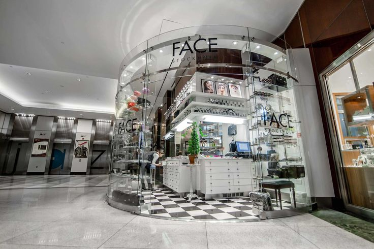 Face Stockholm | Curved Glass Kiosk // custom curved glass 107 square foot kiosk for Face Cosmetics is located in The Shops at Columbus Circle in Manhattan // Retail Design Iron Tempered Glass Aluminum Steel  Millwork Walls