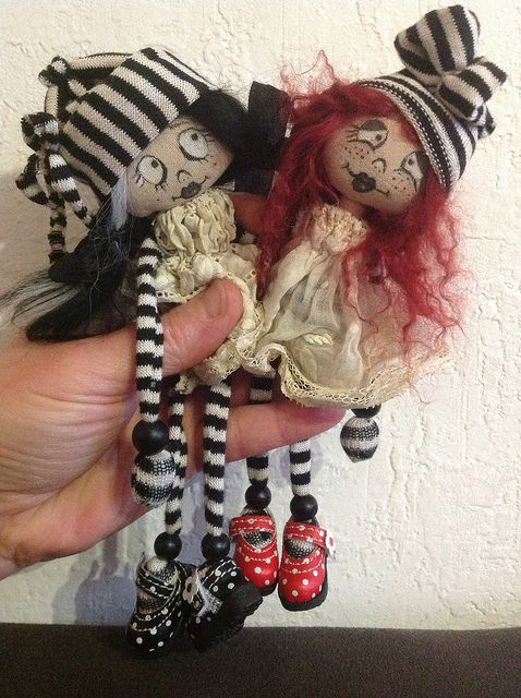 Ragdolls of the day in black and white, yesterdays - Raggedy Ann & Andy in red and white stripes.