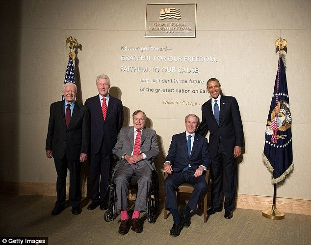 Carter (far left) is pictured alongside fellow former Presidents Bill Clinton, George H.W....