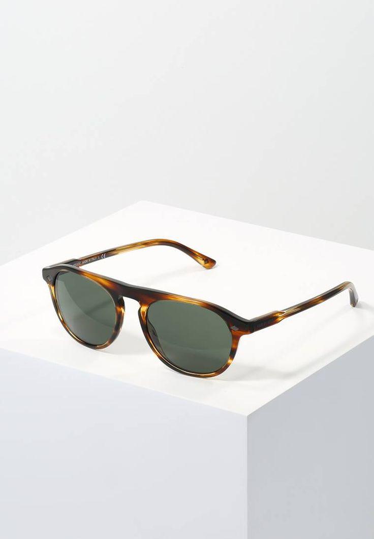 Giorgio Armani. Sonnenbrille - brown/green. Breite:14.3 cm bei Größe 53. Bügellänge:14 cm bei Größe 53. Stegbreite:1.3 cm bei Größe 53. UV-Schutz:ja. Brillenform:oval. Brillenetui:Hartschale