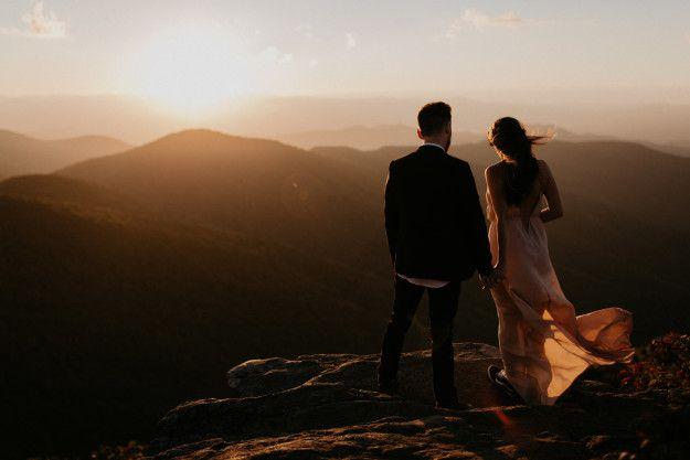 Just a flawless couple enjoying a sunset on a cliff.   25 Incredible Wedding Photos That'll Leave You Speechless