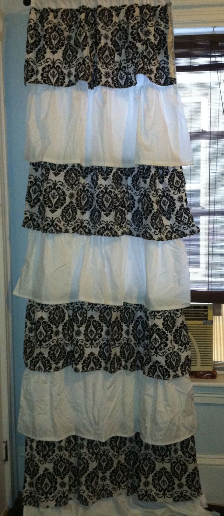 Damask and white ruffled curtains for my Paris theme bedroom