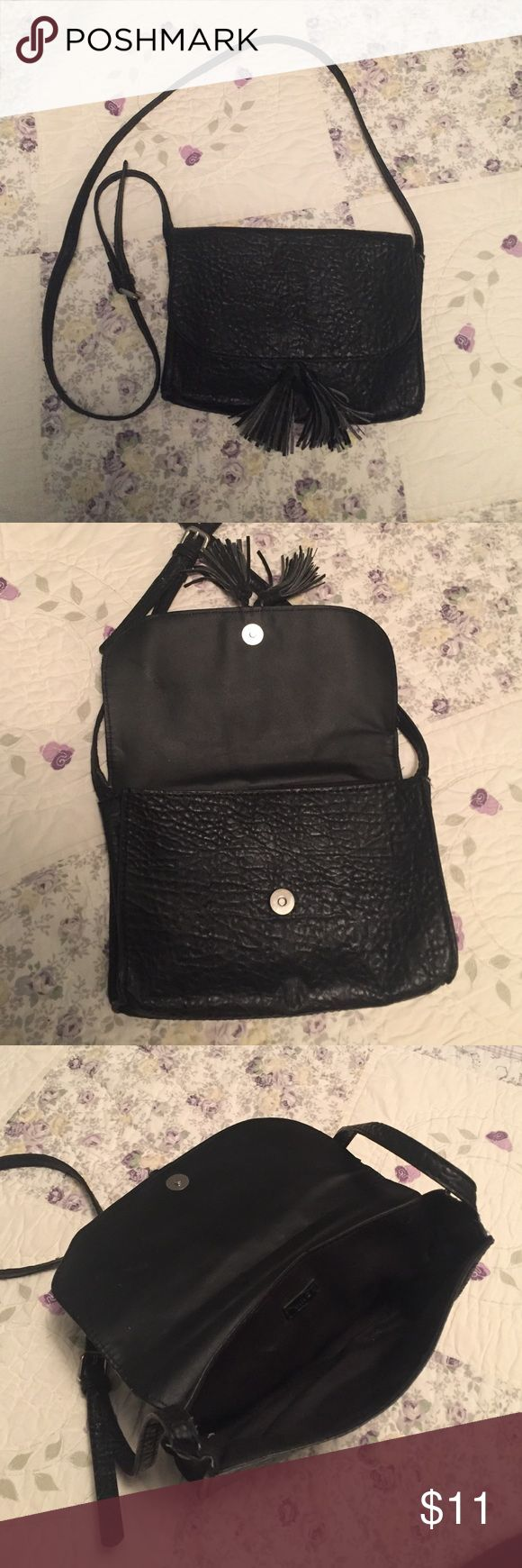 Black textured fake leather purse This purse is lightly used with a magnetic clasp and adjustable strap. It has silver accents and a long strap so it can be worn across the body. Purchased from a Mango store in Milan, Italy. Mango Bags Crossbody Bags