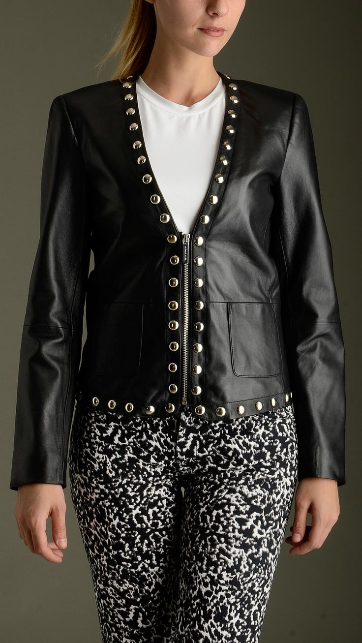 Studded leather jacket in black featuring a wide V neck, long sleeves, zip fastening, two patch pockets at front, cotton lining, exterior: 100�0sheep leather; lining: 100�0cotton.