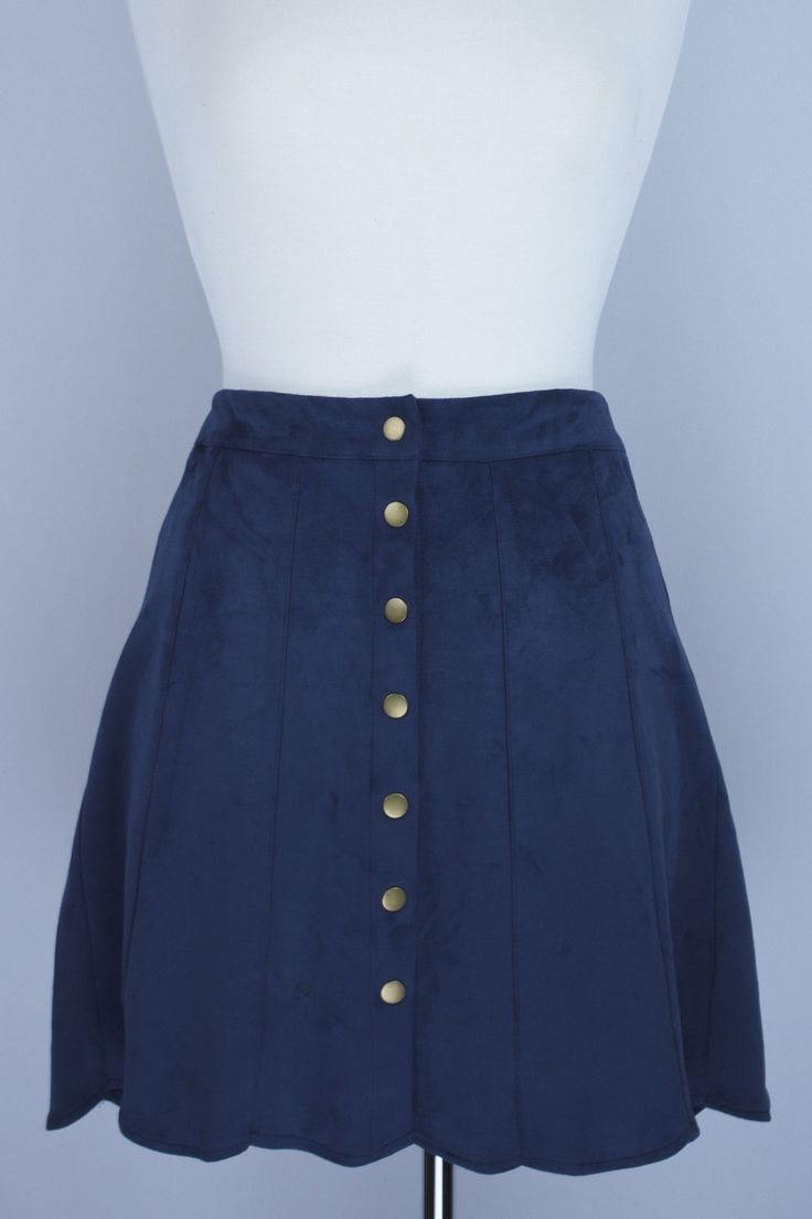 Brass snap buttons, soft faux suede, deep navy, and a scalloped hem. This is the perfect skirt to live in, and live in it you will! High waisted and longer than a mini, it will keep you covered up and