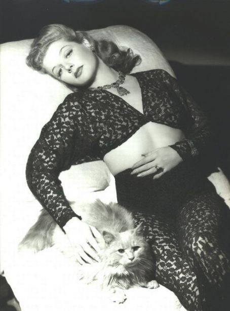 Ann Sheridan with her cat.