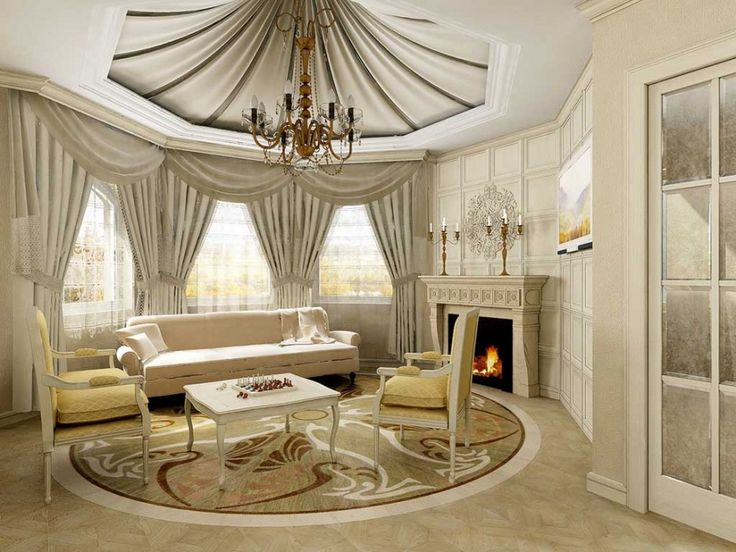 Home Design. Luxury Great Room Designs Ideas. Amazing White Living Room Design Inspiration Featuring Glass Window And White Transparent Fabric Curtain Plus White Fabric Comfy Sofa Together With White Fabric Comfy Cushion And Also White Concrete Fireplace Plus Brown Polished Iron Candle Holder As Well As Picture And Also White Fabric Blanket And Brown Round Floral Pattern Fabric Rug Plus White Stained Wooden Chair With Yellow Rhoumbus Pattern Fabric Comfy Backrest And Cushion And Also White…