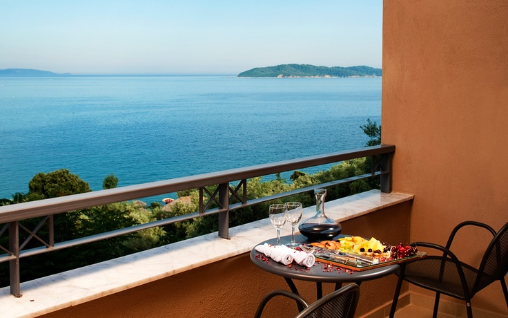 View of the Aegean sea from the balcony of the Double Room of the Kassandra Bay Hotel in Skiathos. Visit www.kassandrabay.com/double-rooms-skiathos for more information.