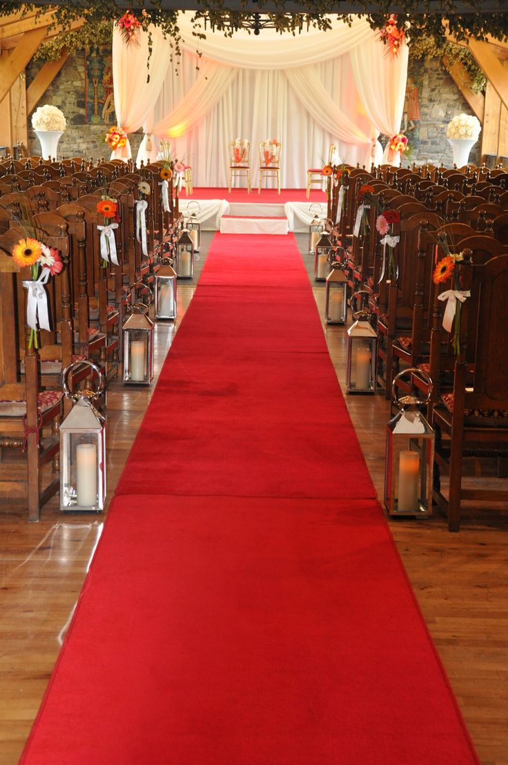 Red Carpet Aisle Runner at a colorful wedding reception. www.gotchacovered.ie