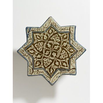 Tile        Place of origin:        Kashan, Iran (made)      Date:        early 14th century (made)      Artist/Maker:        Unknown (production)      Materials and Techniques:        Fritware, glazed and painted in cobalt blue and lustre