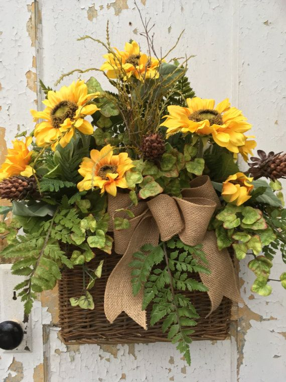 Sunflower Wall Basket, Summer Wall Basket, Summer Wreath Basket, Sunflower Wreath  This warm and welcoming sunflower wall basket will greet your guest to your home. It is filled with beautiful sunflowers, varigated ivy, floral accents, greens, grass, ferns and a burlap bow. Thank you for visiting my shop