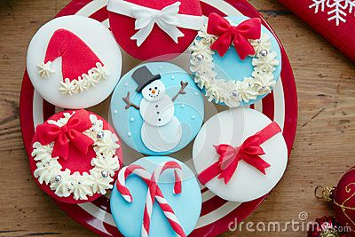 Cupcakes decorated with a Christmas theme