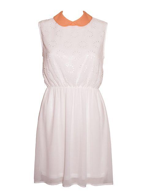 Krótka sukienka z okrągłym kołnierzykiem w kontrastowym kolorze.