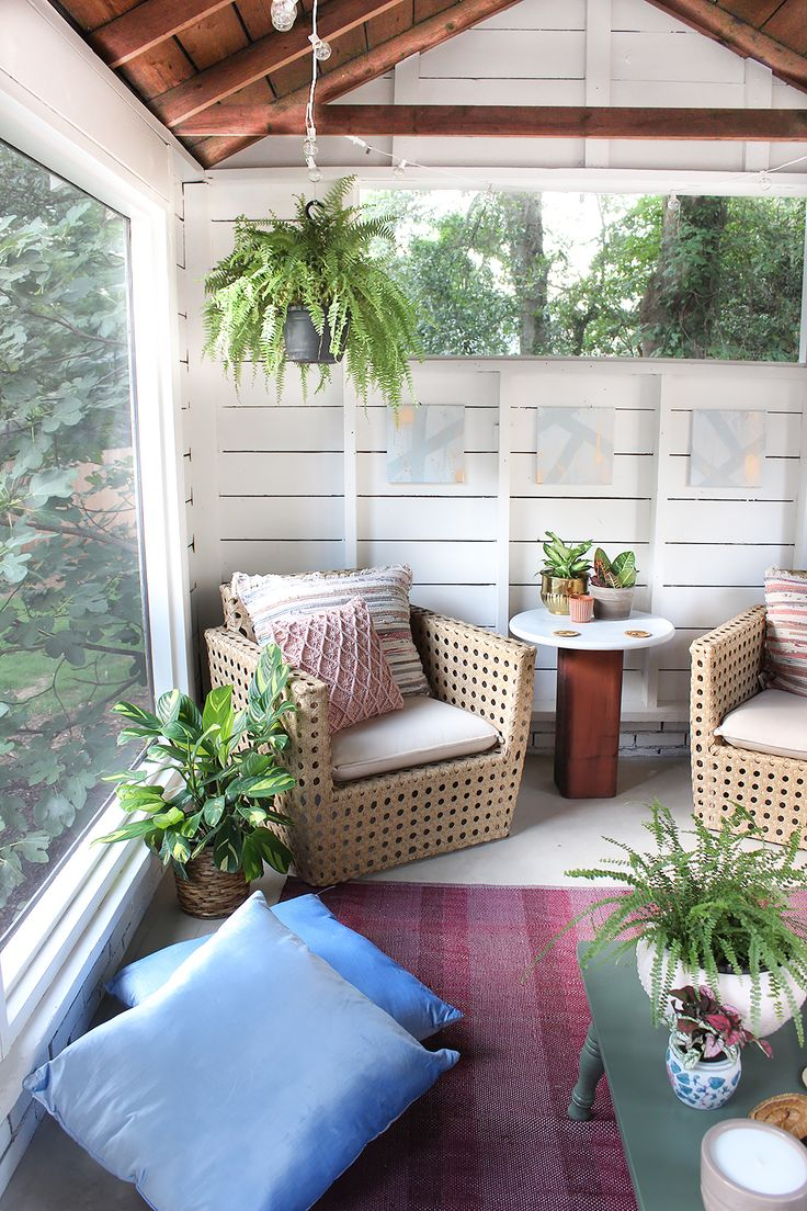 Come inside this shed turned screened porch for tons of boho design ideas. We especially love the calming yet colorful, greenery-filled lounge space.