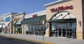A variety of commercial aluminum awnings making this shopping center stand out