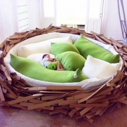 Designed by the team at O*GE, this massive bed replicates a bird nest in human size proportions